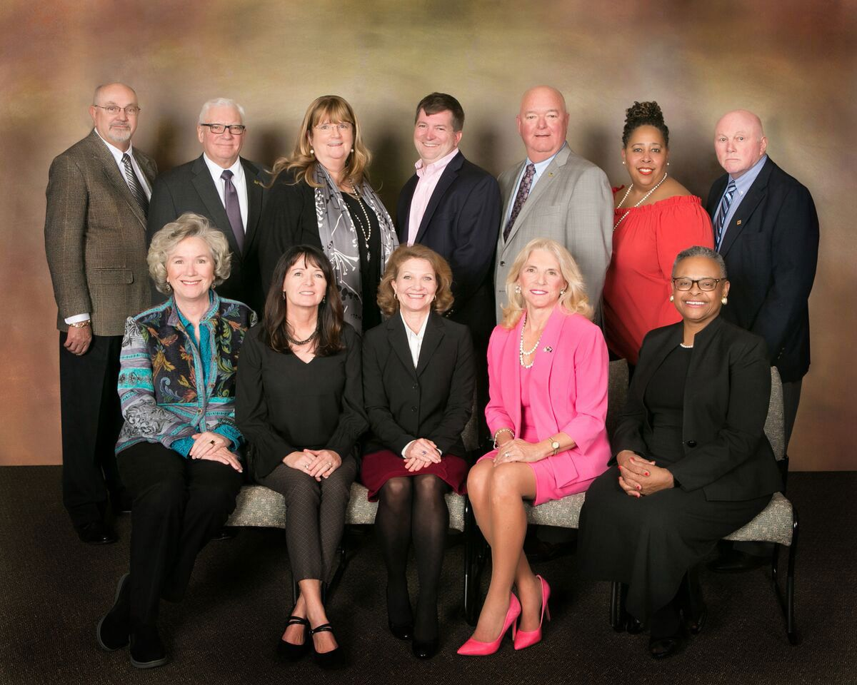 Greenville County Schools Board of Trustees. Bottom row, l to r: Dr. Crystal Ball O'Connor, Lisa Wells, Joy Grayson, Lynda Leventis-Wells, Glenda Morrison-Fair.  Back row, l to r: Roger Meek, Roy Chamlee, Debi Bush, Derek Lewis, Chuck Saylors, Michelle Goodwin-Calwile, Pat Sudduth.