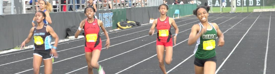 High school girls running in track event