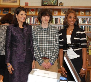 Governor Nikki Haley, JL Mann Sophomore and Book Illustrator Matthew Lynn, JL Mann Junior and Book Author Angel McGowan.