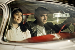 Broadway Musical Grease presented by the Woodmont High Wildcats - scene where couple are sitting in front seat of a car