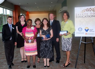 Pictured, left to right: Matt Tebbetts, Greenville Federal Credit Union; Kelly Adams, Lakeview Middle; Jackie Gibson, Berea Middle; Ramona Woo, Special Education Services; Dr. Cindy Alsip, J.L. Mann High Academy; Doug Chappell, Finance; and Dr. DeeDee Washington, Brushy Creek Elementary School.