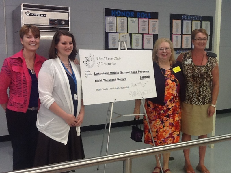 L to R: Ruth Morrow and Beth Braswell from the Music Club of Greenville; Lakeview Middle Band Director Jessica Morgan and Dr. Tracy Hall, Lakeview Middle Principal.