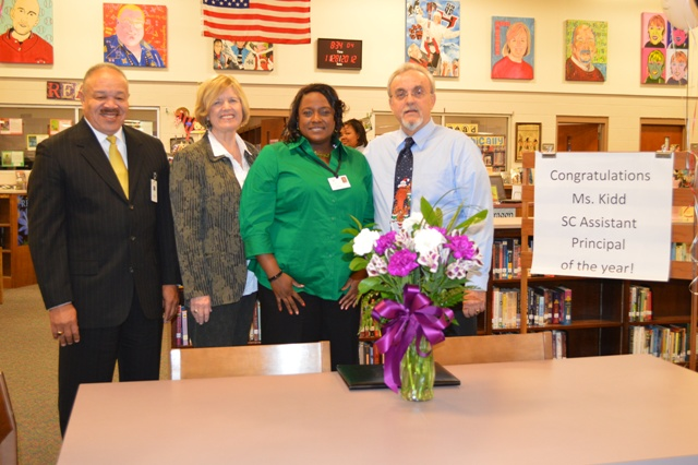 Group photo, left to right: Dr. Ken Peake, Assistant Superintendent of Principal Supervision; Molly Spearman, Executive Director, South Carolina Association of School Administrators; Jada Kidd, Assistant Principal; Steve Chamness, Principal, Hillcrest High.