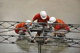 men working on scaffolding