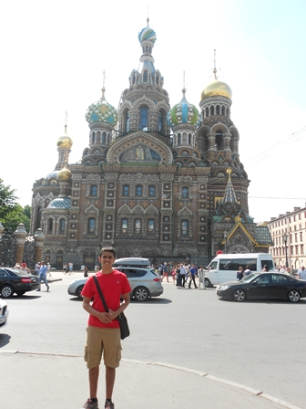 Nishesh Chaubey posing in front of a large Russian building