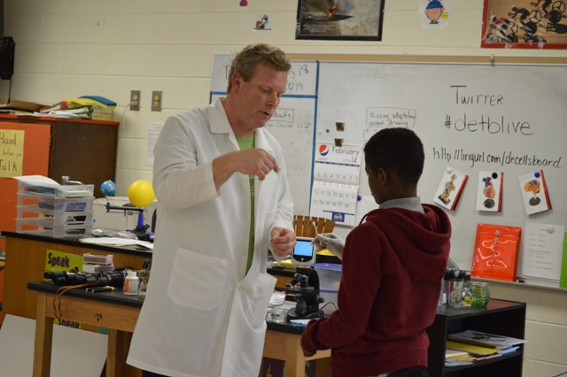 Scientist talking with student