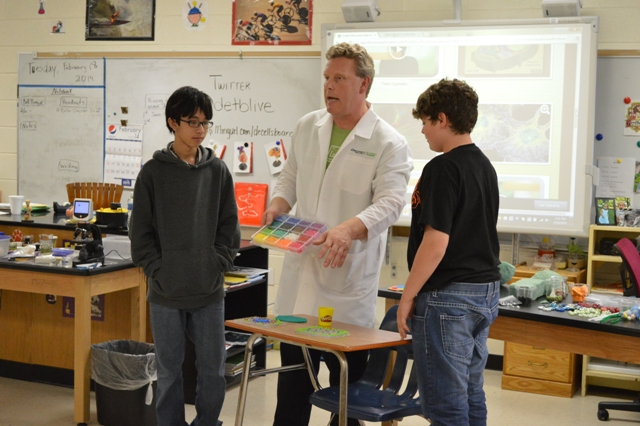 Scientist with two volunteer students