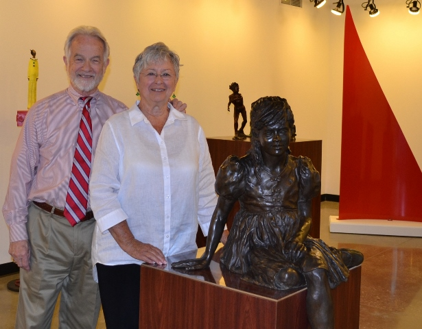Dr. Roy Fluhrer (left), Fine Arts Center Director with local artist Zan Wells (right)