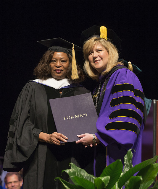 Lillian Brock Flemming Honored at Furman University Convocation posing with her diploma