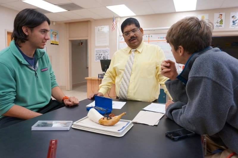Male teacher with two male students