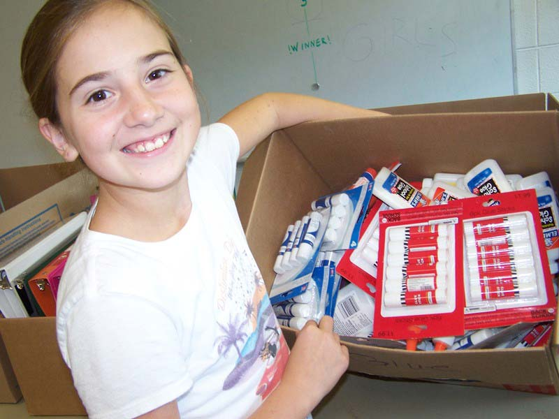 1 female student posing with a filled box