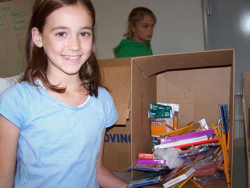 Female elementary student #3 posing with a filled box