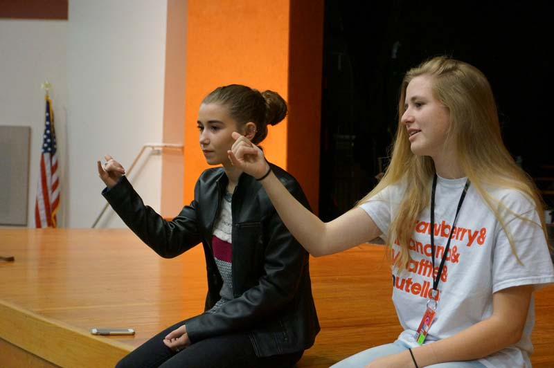 Natalie Herdon, left, and Sarah Justus teach Mauldin High students to use sign language.