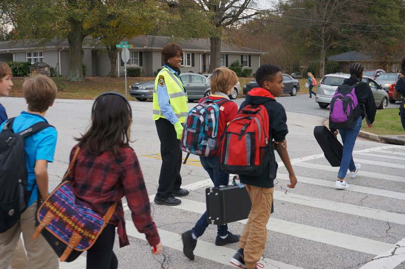 Marcel McNeil helping a group of students cross the road