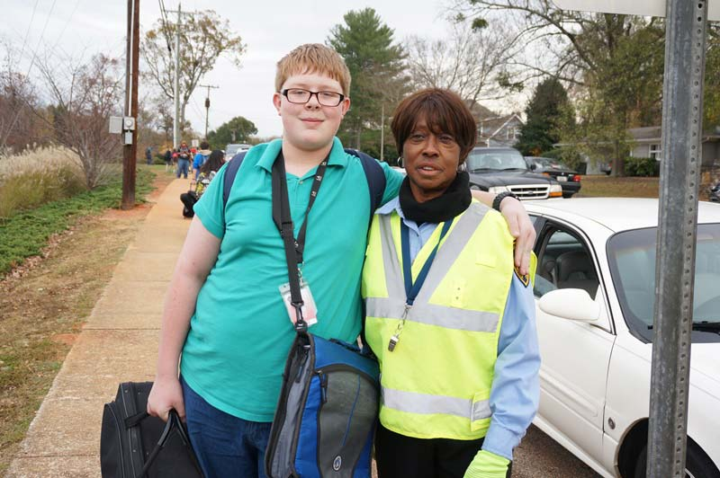 Crossing Guard Marcel McNeil with male student