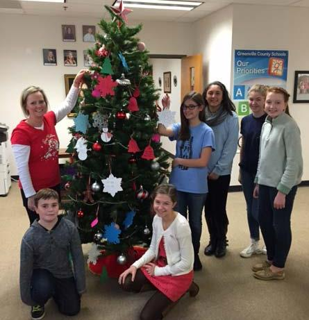 Pictured above taking ornaments from the Giving Tree are L-R:  Bradi Larobardiere – RCMS parent, Justice Lawrence – secretary of Student Council, Kimberly Hernandez – Vice President of Student Council, Reyn Wills – President of Beta Club, Audrey Goodwin – Vice President of Beta Club.  L-R in front are Chase Larobardiere – student, and Megan Wetherald – President of Student Council