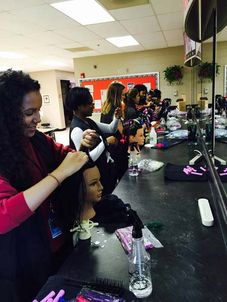Cosmetology students practicing on mannequins