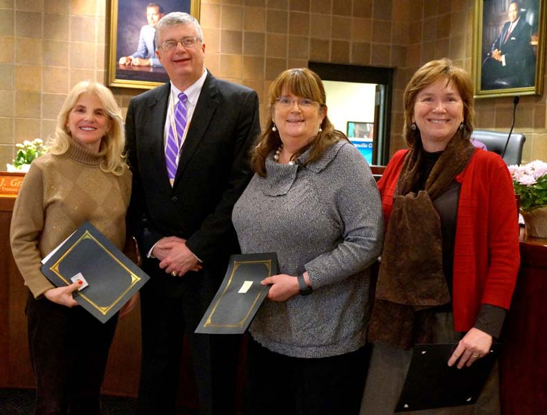 Dr. Royster recognizes Lynda Leventis-Wells, Debi Bush, and Dr. Crystal Ball O'Connor for their years of service.