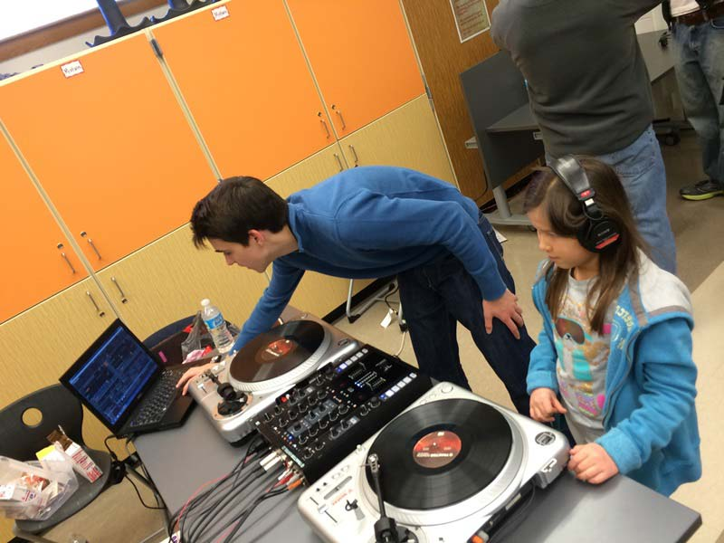 students experimenting with vinyl records