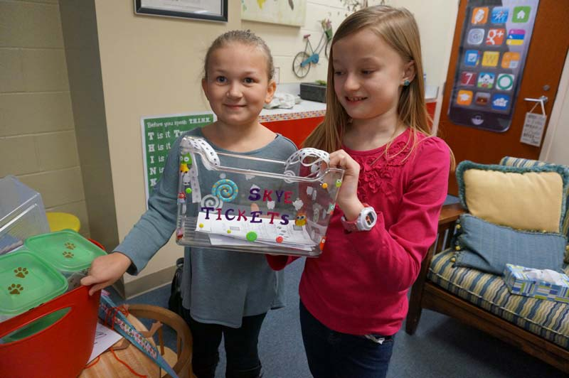Kennedy and Allie, two third graders, are responsible for collecting and sorting Skye tickets.