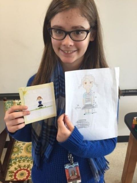 female student #2 with two cross stitch examples