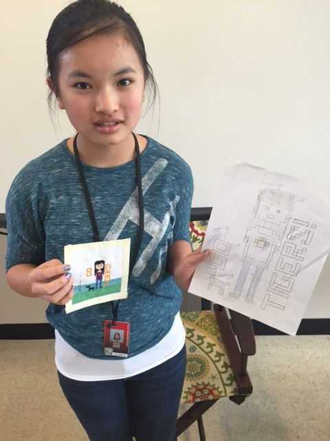 female student #3 with two cross stitch examples