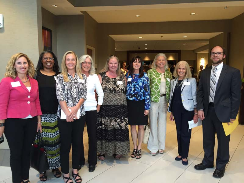 Greenville County Schools Board of Trustees Chair Lisa Wells, Washington Center Principal Penny Rogers, Sara Collins Principal Melissa Burns and Washington Center parents and staff receive a $35,450 grant from Greenville Women Giving to create a handicapped-accessible nature trail.