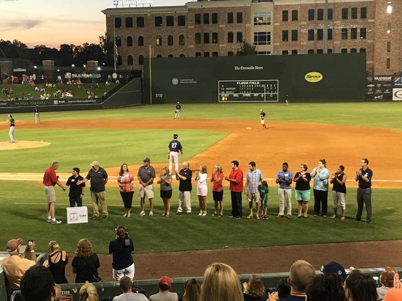 Dr. Burke Royster and school representatives were on hand at Monday's Greenville Drive game as GE Power and 3D Systems donated 14 Cube 3 printers to Greenville County Schools. - photo of group show at Greenville Drive field