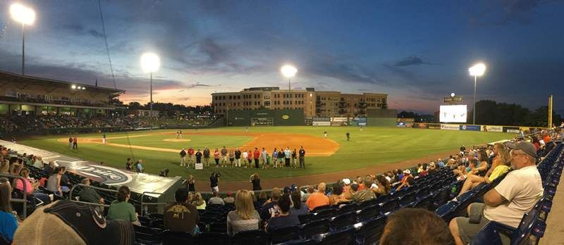 Dr. Burke Royster and school representatives were on hand at Monday's Greenville Drive game as GE Power and 3D Systems donated 14 Cube 3 printers to Greenville County Schools - photo of distant show of presentation on Greenville Drive field