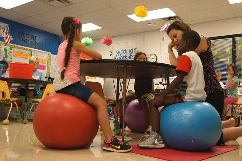 Students sitting on yoga balls