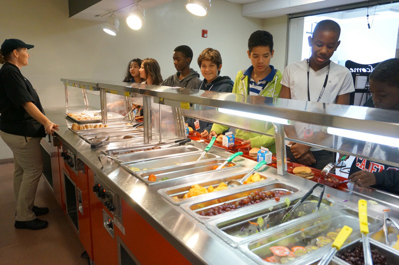 Lunchroom Lady serving a group of students