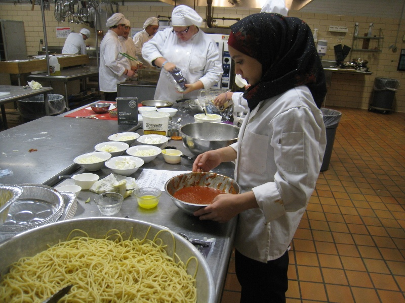 Bonds Career Center culinary students prepare casseroles for Greer Community Ministries' Big Thursday event.  Photo 2