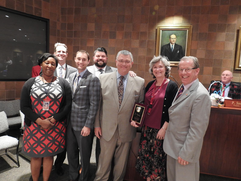 Marjon Ford (Carolina Assistant Principal), Michael Delaney (Carolina High Principal), Jeremy Simmons (Herff Jones), Andy Waters (Herff Jones), Harold Waters (Herff Jones), Dr. Crystal Ball O'Connor (School Board), Dr. Tom Dobbin (SCSBA)