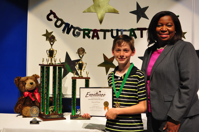 Caleb Govert with Greenbrier Principal Lekeisha Brown