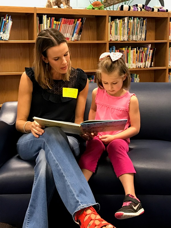 Plain Elementary PTA - PTA mother reading to female student
