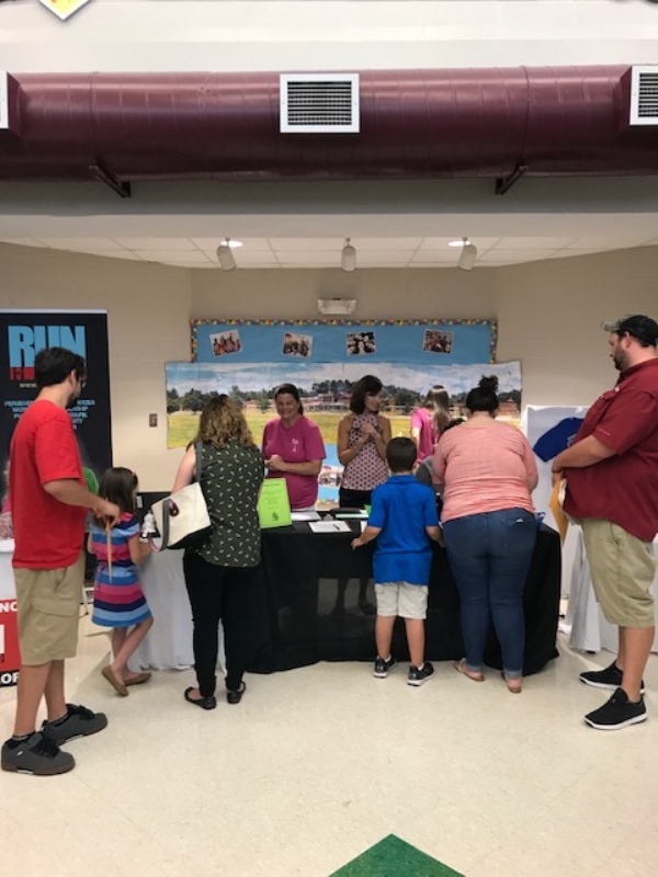 Simpsonville Elementary PTA - group around display table