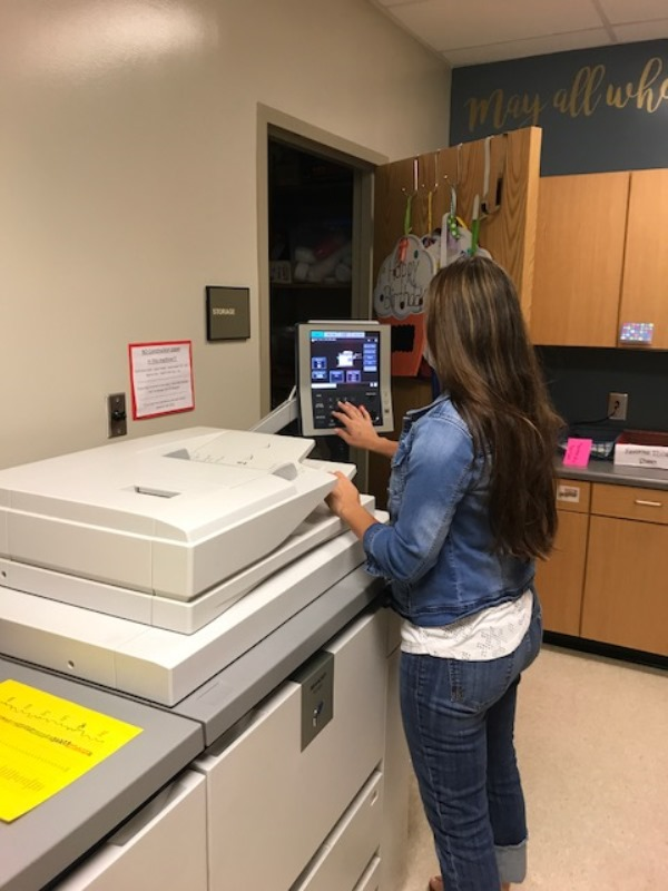 Simpsonville Elementary PTA - female making copies at a copy machine