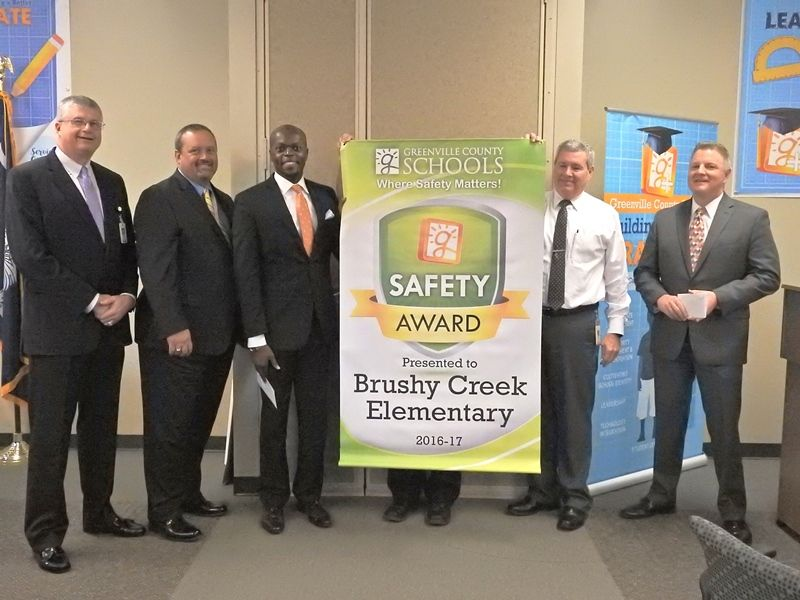 L to R: Superintendent Burke Royster, Deputy Superintendent Mason Gary, Principal Charles Davis, Employee Relations Representative Marque Kilpatrick, Director, Payroll/Insurance Services Jamie McCutcheon