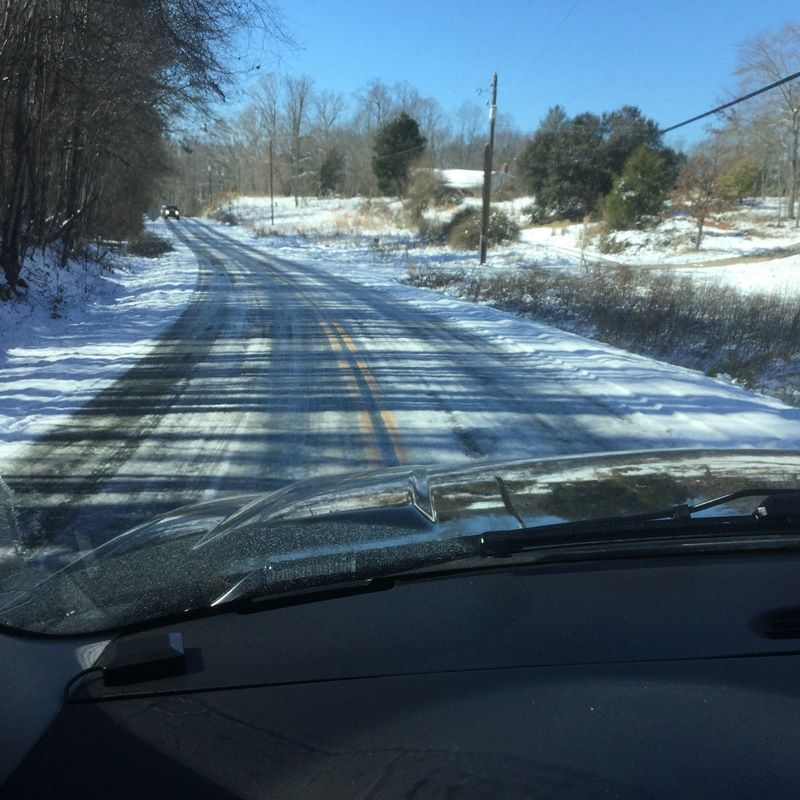 photo graph of icy roads from a driver's perspective