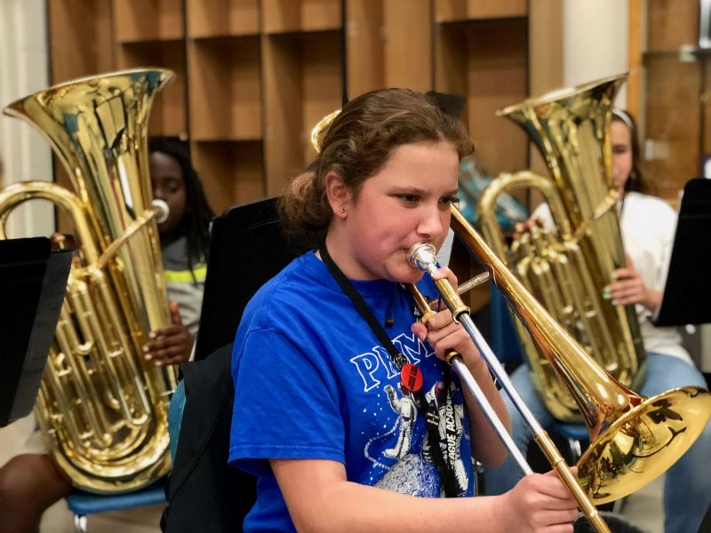 1 female student playing horn