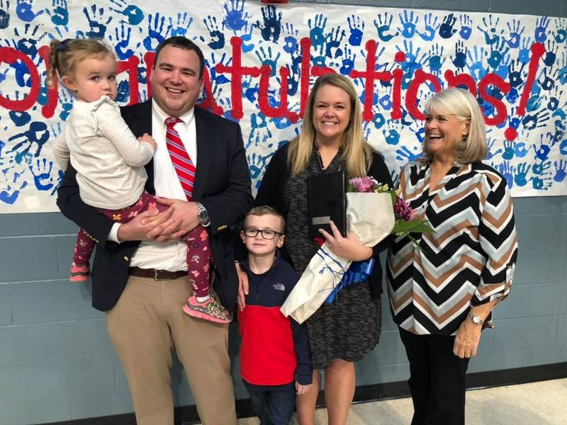 Stafford is pictured with her husband Todd, an Assistant Principal at Greer High School, their two children and her mother.