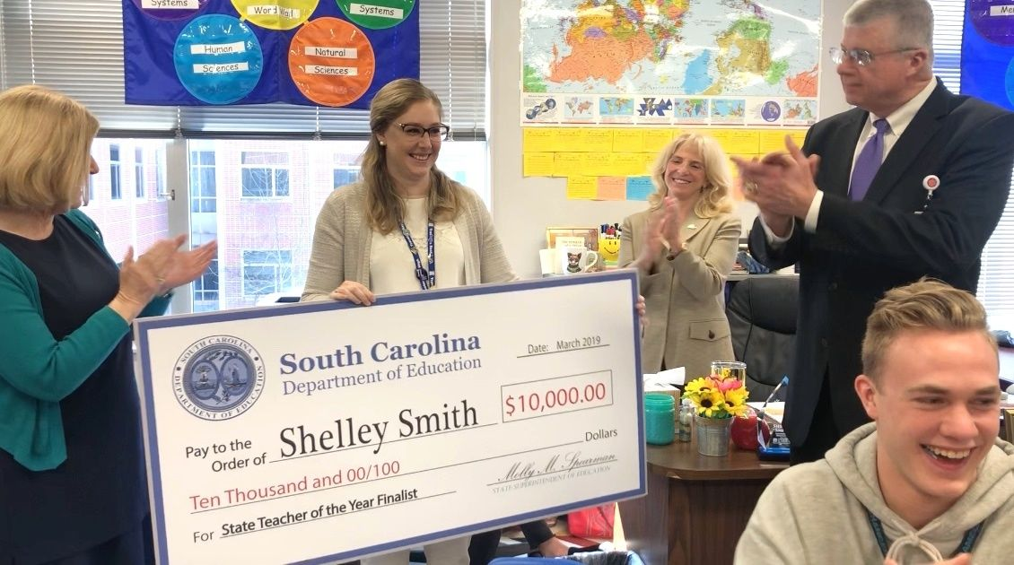 Shelley Smith receives check