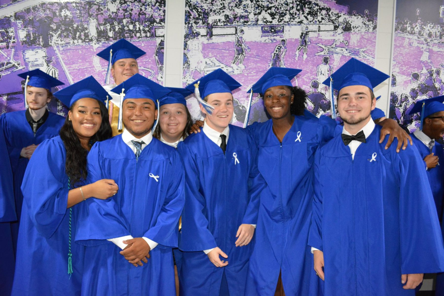 Group of high schools students in graduation regalia