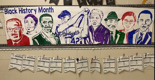 A photo of a 5th grade art project of a poster of famous figured in black history
