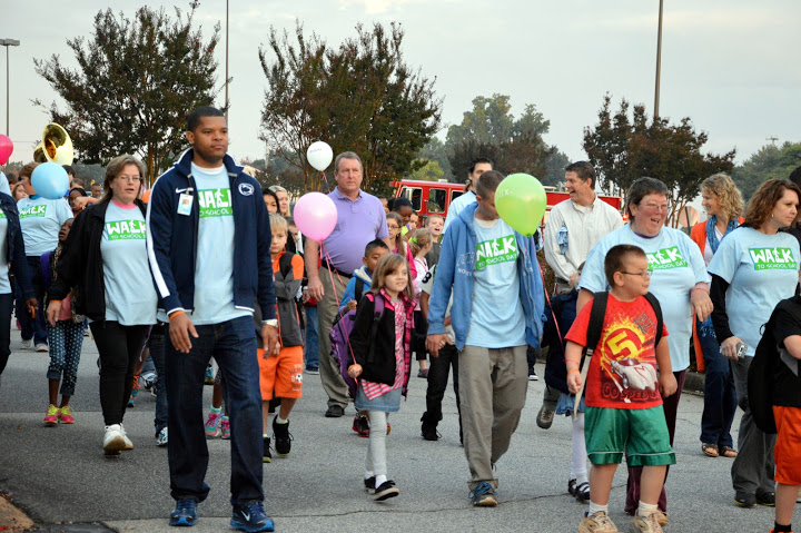 Parents, teachers, administrators, students, and community members walked to school.