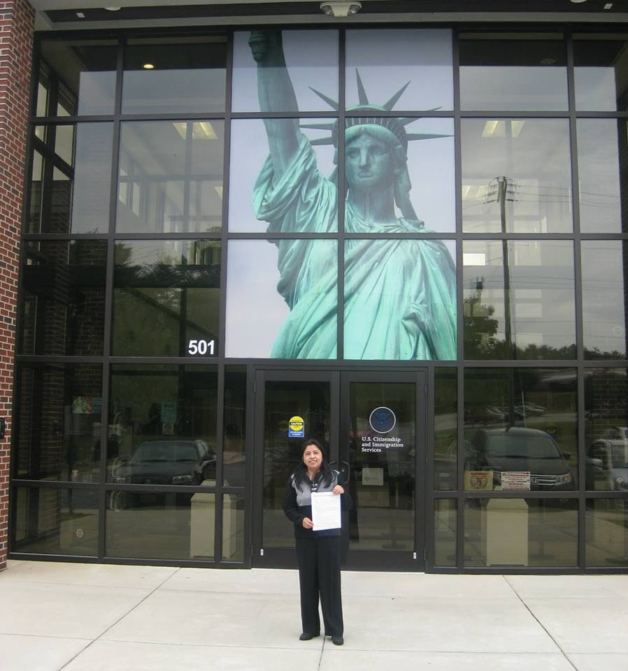Posing with citizenship papers