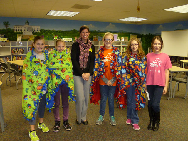 Girls on the Run team members made and donated blankets to Safe Harbor