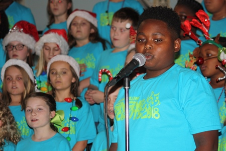 soloist sings at concert