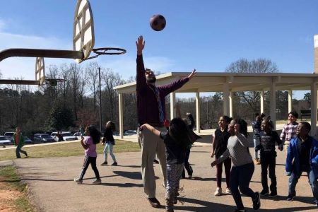 Mr. Moser plays ball with 1st graders