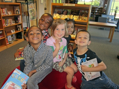 photo of a group of elementary children in a school library